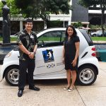 Michelle Cordero-Lee, Hawaii Meals on Wheels CEO receiving electric vehicle from Hawaiian Electric Industries