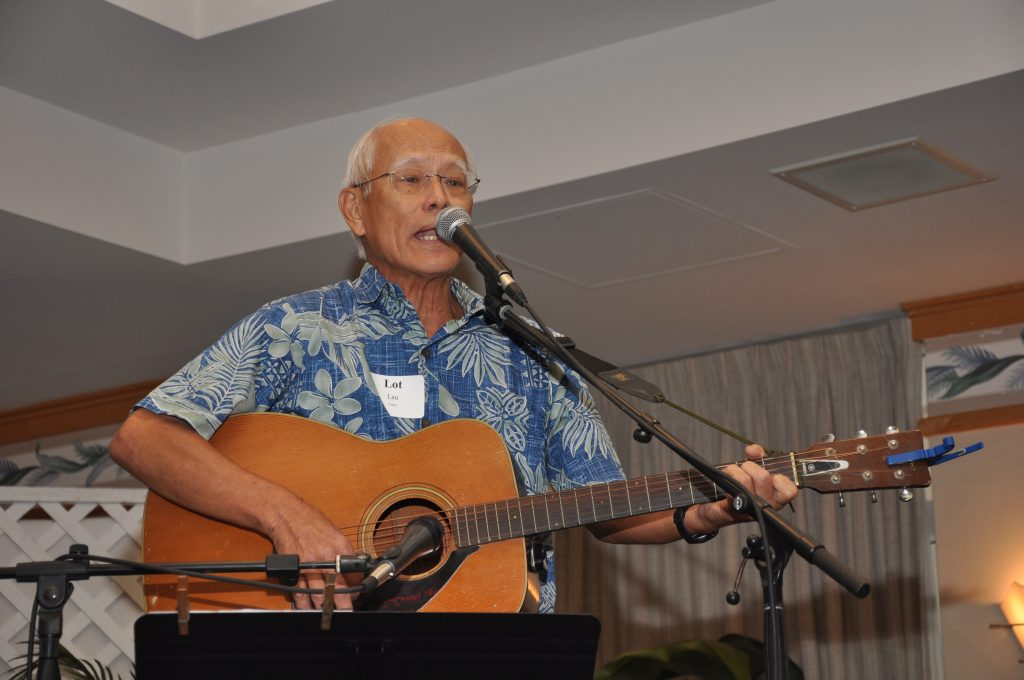 "Volunteer and former board member Lot Lau sings his composition ""Holoholo Ka'a with Hawai'i Meals on Wheels"